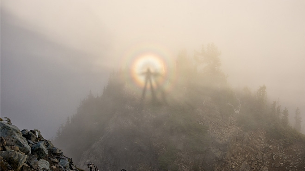 Climbers create their own amazing shot of 'Brocken Spectre'